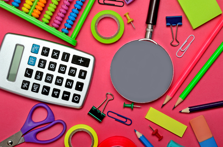 Stationary office tool on pink background
