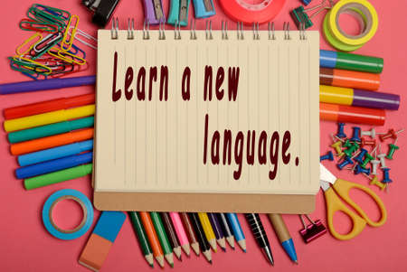 fluency: Learn a new language written on notebook Stock Photo