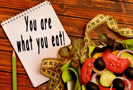 what to eat: You are what you eat written on notebook Stock Photo