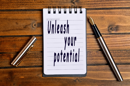 unleash: Unleash your potential text written on notebook
