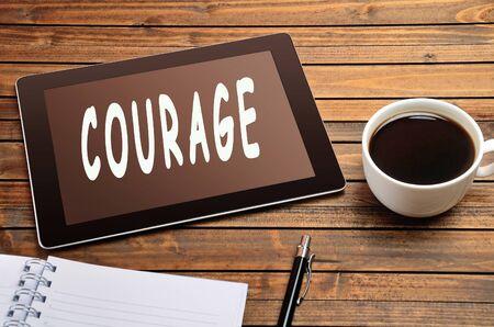 unafraid: Courage word on digital tablet