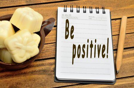 positivity: Be positivity words on notebook Stock Photo