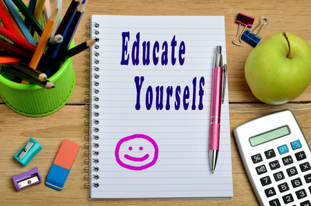 yourself: Educate yourself words on notebook