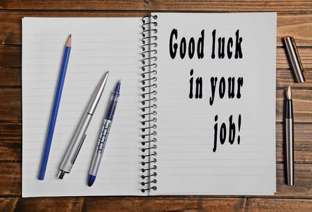 Good luck in your job written on notebook