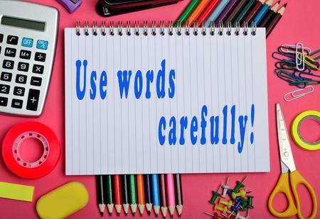 carefully: Use words carefully written on notebook Stock Photo