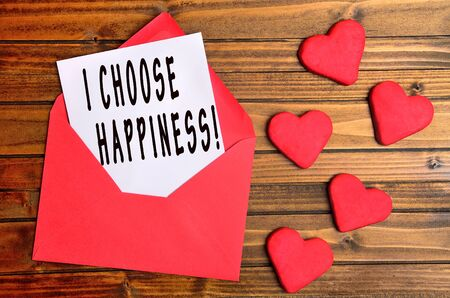 love shape: I choose happiness words on paper