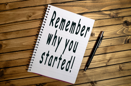 positiveness: Remember why you started words on notebook