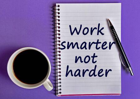 harder: Work smarter not harder words on notebook