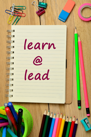 learn and lead: Words Learn @ Lead on notebook Stock Photo