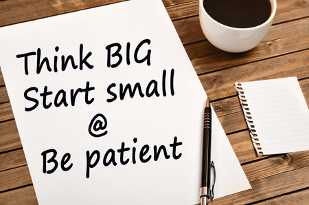 Words Think big Start small and Be patient on paper
