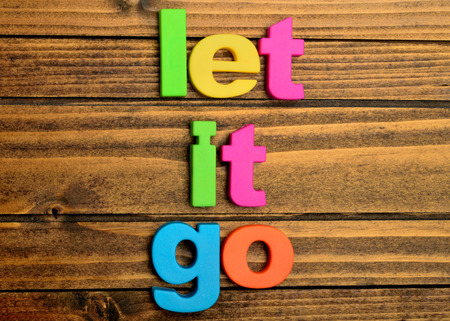 let go: Words Let it go on wooden table