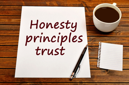The words Honesty principles trust on white paper