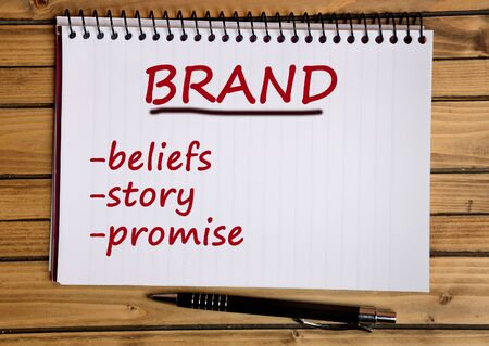 campaign promises: Brand word on notebook page