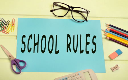 The words School rules on paper
