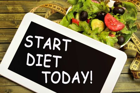 The words Start diet today on tablet pc