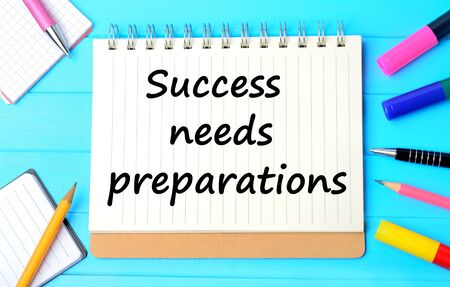 strategic focus: The words Success needs preparations on notebook