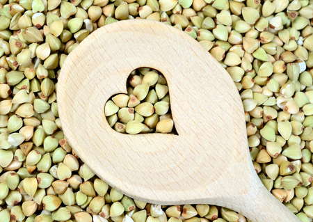Green buckwheat with lovely wooden spoon
