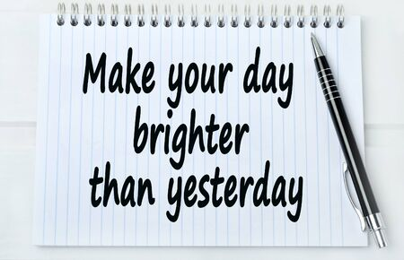 brighter: Text Make your day brighter than yesterday on notebook Stock Photo