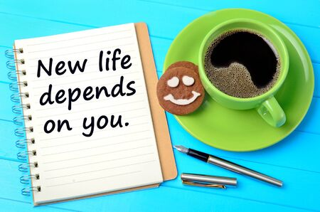 depends: The words New life depends on you on notepad