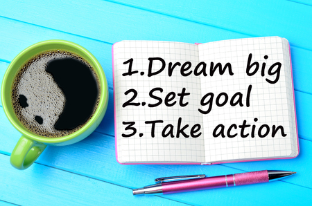 set goal: Text Dream big Set goal Take action on notepad Stock Photo