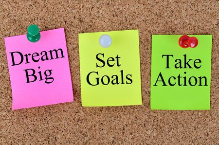 take action: Dream big Set goals Take action written on colorful notes