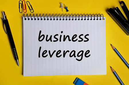 leverage: Business leverage words written on notebook Foto de archivo