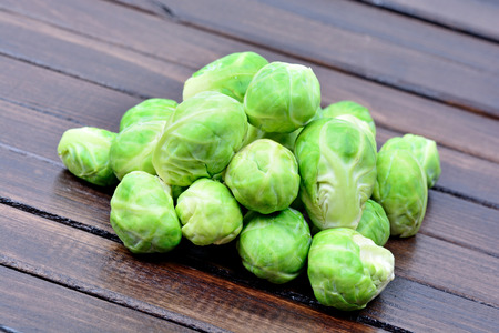 Group of brussels sprouts on wooden table Stock Photo