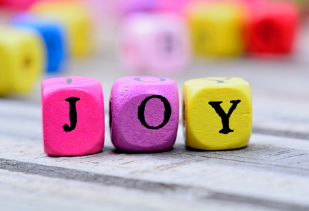 Joy word on gray wooden table Archivio Fotografico
