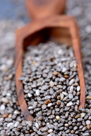 wooden scoop: Wooden scoop with chia seeds closeup Stock Photo