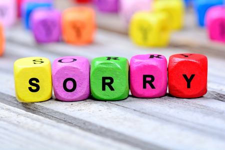 Sorry word on wooden table