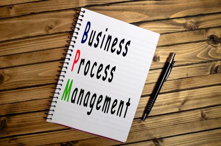 bpm: Business Process Management words on notebook