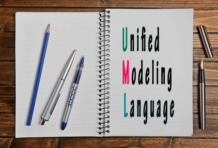 unified: The words Unified Modeling Language on notepad page Stock Photo