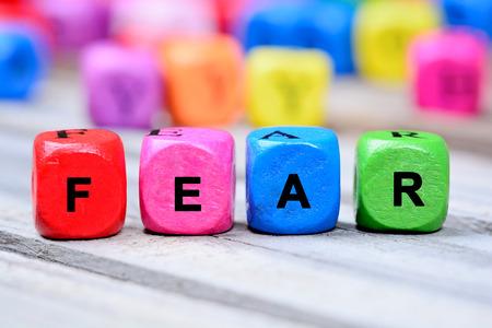 fear: Fear word on wooden table