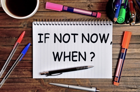 when: Question If not now,when on notebook page Stock Photo