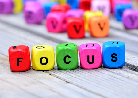 focalise: Focus word on wooden table Stock Photo