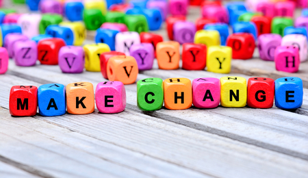 school strategy: The colorful words Make Change on wooden table