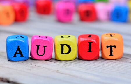 Audit word on grey wooden table Stock Photo