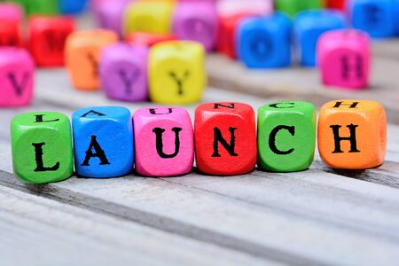 Launch word on wooden table Stock Photo