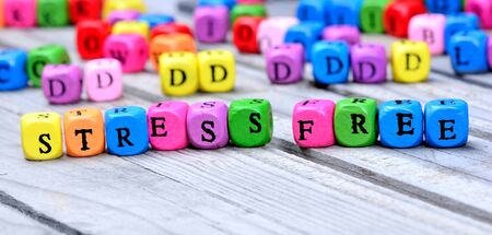 trouble free: Stress free word on wooden table Stock Photo