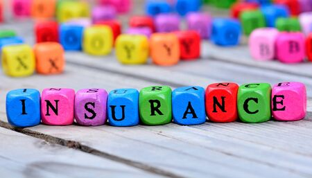 Insurance word on wooden table