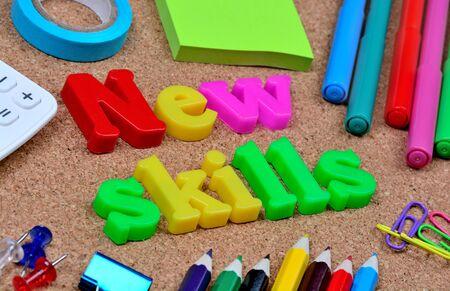 New skills word on cork background Stock Photo