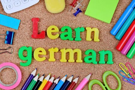 Learn german words on cork background closeup Stock Photo