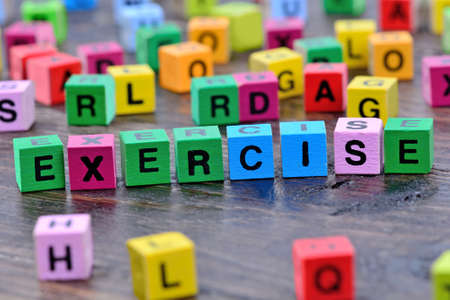 keyword: Exercise word on wooden table