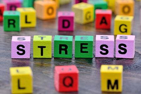 The word Stress on wooden table