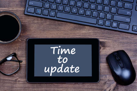 modernization: The words Time to update on digital tablet pc