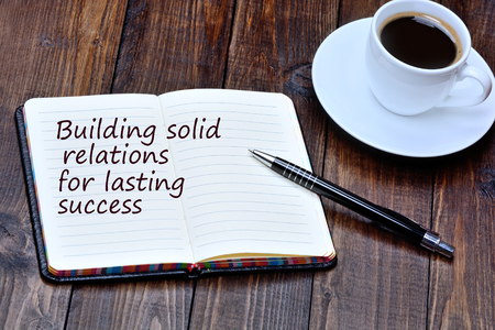 Building solid relations for lasting success on notebook page Фото со стока