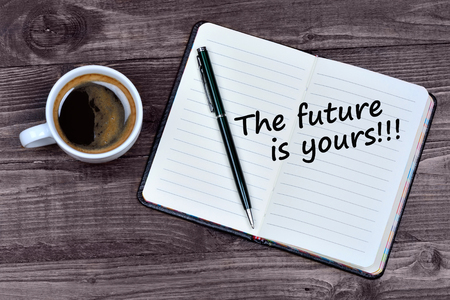 Text The future is yours on notebook page Banco de Imagens