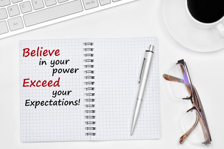 Believe in your power Exceed your expectations text on notebook on a white background Stok Fotoğraf - 98435660