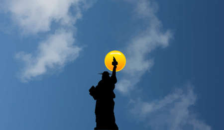 The night is coming as the sun goes down on the Statue of Liberty....Immigrants see her,  after crossing the ocean from Europe...