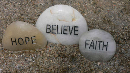 3 rocks with strong words, reflecting life, as they rest in the wet sand. Stock Photo - 5164636